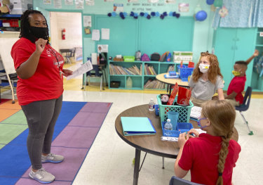 Primary school students at Northeast Lauderdale Elementary in the US, where students are required to wear masks.
