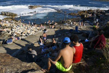 People flock to Sydney beaches as the temperature hits 28 degrees.