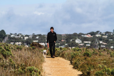 Shaw walking above the cliffs east of Anglesea.