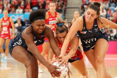 Swifts captain Maddy Proud battles with Mwai Kumwenda and Kate Eddy for the ball.