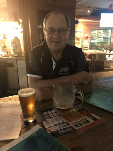 Tom Raudonikis toasts his rude health with the author at the Boomerang Bar in Singapore last Friday.