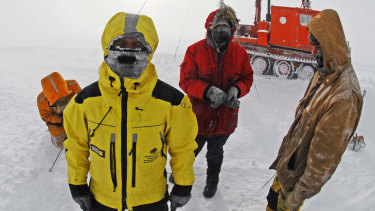 Workers setting up an automatic weather station in Antarctica.
