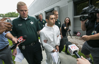 A shackled Sky Bouche, 19, is led to the court.