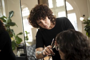"""""""It's crazy,"""" says hairstylist Kate De Pasquale, pictured at A + H salon, in Sydney's Newtown, about the strict rules of the Curly Girl Method; flouting them, she says, has got her kicked off a CGM Facebook group."""