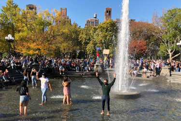 Jubilant scenes: New Yorkers danced in a fountain in Washington Square Park.