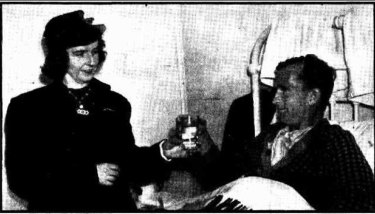 'Max Thomas in Yaralla Military Hospital, being handed a glass of water by his wife.' The Sun, July 20, 1941
