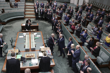 Prime Minister Scott Morrison is congratulated by MPs in the House of Representatives after the Senate passed his income tax cut package.