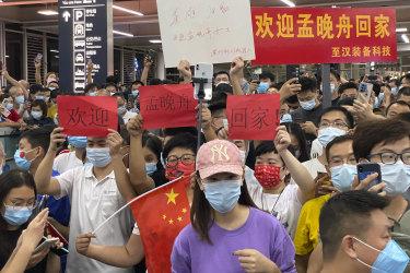 Supporters of Huawei CFO Meng Wanzhou gather at Shenzhen Bao'an International Airport in Shenzhen in southern China's Guangdong Province.