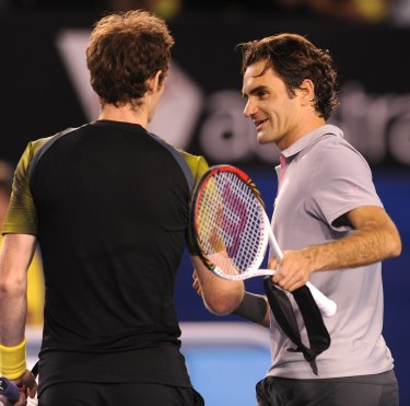 Andy Murray and Roger Federer share a moment at the 2013 Open.