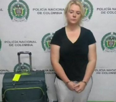 Cassandra Sainsbury was photographed beside her luggage.