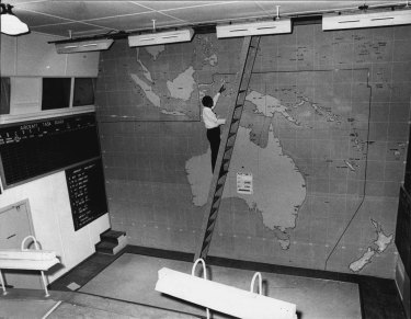 Mr P. Engisch examines the 1942 main South Pacific aircraft task board at the underground Bankstown RAAF site.