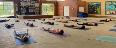 Wembley Downs Primary School students lay in savasana as part of their mindfulness practice.