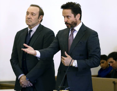 Actor Kevin Spacey stands in district court with his attorney Alan Jackson.