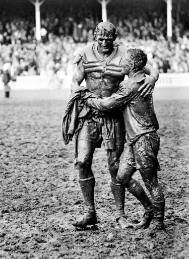 Gladiators . . . John O'Gready's iconic image of St George captain Norm Provan and Wests' Arthur Summons after the 1963 grand final.