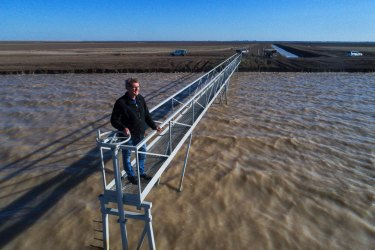 Ian Cole from Barwon-Darling at a dam for a cotton farm near Bourke that filled up after good rains last year.