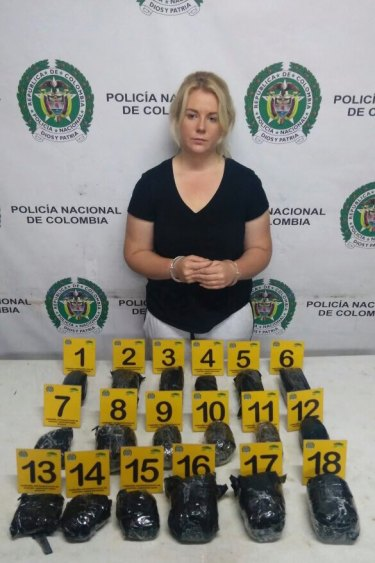 Colombian police released this photo of Cassandra Sainsbury with the alleged drugs.