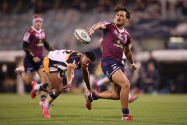 Jordan Petaia offloads in the Super Rugby AU grand final last weekend.