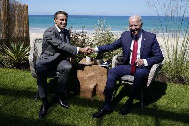 President Joe Biden and French President Emmanuel Macron visit during a bilateral meeting at the G-7 summit.