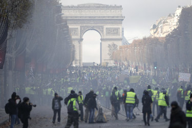 A cloud of tear gas fills the air on the streets of Paris.