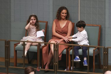 Amie Frydenberg with children Gemma and Blake as Treasurer Josh Frydenberg delivers the budget in the House of Representatives on Tuesday night.