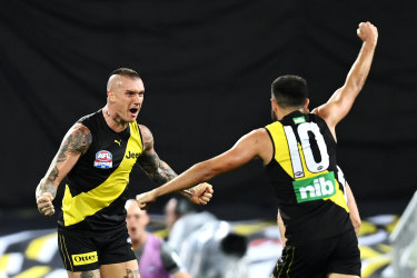 Dustin Martin of the Tigers celebrates kicking a goal with teammate Shane Edwards.