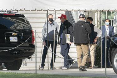 Trump prepares to enter his motorcade.