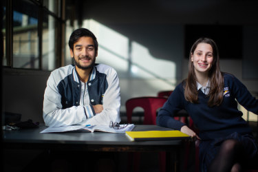 Year 12 students at Thornbury High  Keeran Ramasamy and Isabelle Magiatzis are excited to be back in school.