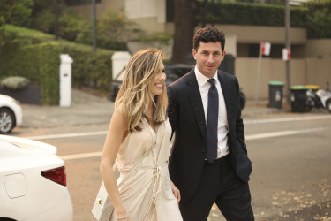 Claire  and Ryan Stokes arrive at Christmas drinks at fellow media heir Lachlan Murdoch's home.