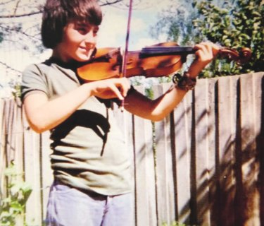 Warren Ellis at age 12, with his violin.