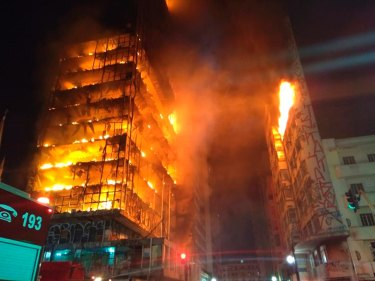 The burning building in downtown Sao Paulo, Brazil, which collapsed mid rescue in the early hours of Tuesday morning, local time.