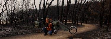 Kristin Ruleon her bike with viola in Mallacoota.