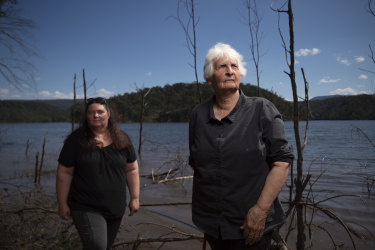 Traditional owners Aunty Sharyn Halls (right) with Kazan Brown stand beside Lake Burragorang in Sydney's Special Areas. Lake levels will rise as much as 17 metres if the height of the Warragamba Dam wall is raised, consigning hundreds of Indigenous sites to destruction during a big rain event.