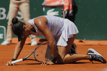 Japan's Naomi Osaka gets up after slipping during her third round match of the French Open.