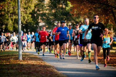 Parkrunners get cracking in Tuggeranong, one of the Canberra events called off due to excessive smoke.