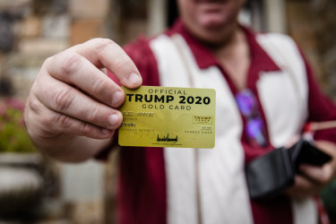"""Alec shows off his """"Official Trump 2020 Gold Card"""" which he says he got for contributing to the campaign."""