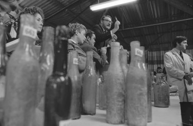 Auction of old bottles at Parramatta on May 20, 1970. Pictured is auctioneer Bob Steer.