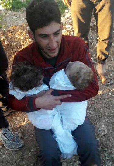 Abdulhamid al-Youssef holds his twin babies who were killed during a suspected chemical weapons attack in Khan Sheikhoun town, in the province of Idlib, Syria