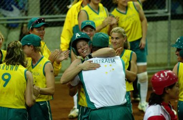 Peta Edebone is mobbed at home plate after hitting the winner against China at Blacktown, guaranteeing Australia a softball medal at the 2000 Olympics.