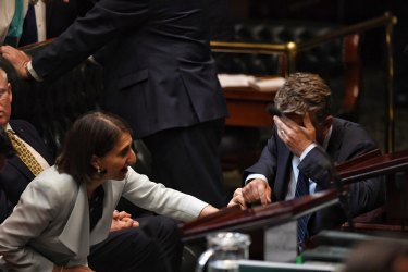 The Premier supports an exhausted Andrew Constance in Parliament in February.