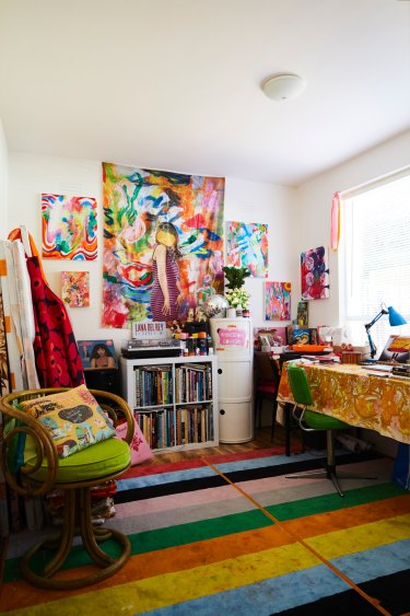 Minna's passion for colour and kitsch runs at full strength in her studio. The rug is from IKEA and the cane chair from Waverley Antique Bazaar.