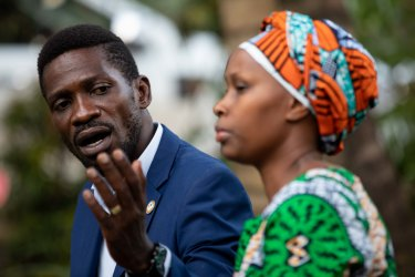 Bobi Wine addresses the media as security forces surround his home.