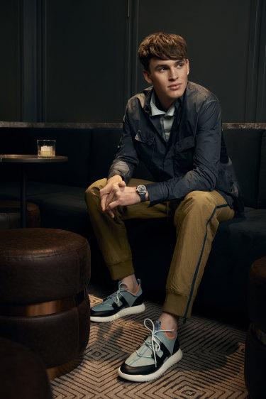 Zane wears Hermès jacket, $1515, shirt, $1345, pants, $2225, and trainers, $1350, and Omega watch,$9250.