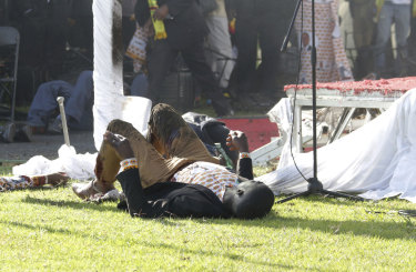Injured people lay on the ground following the explosion.