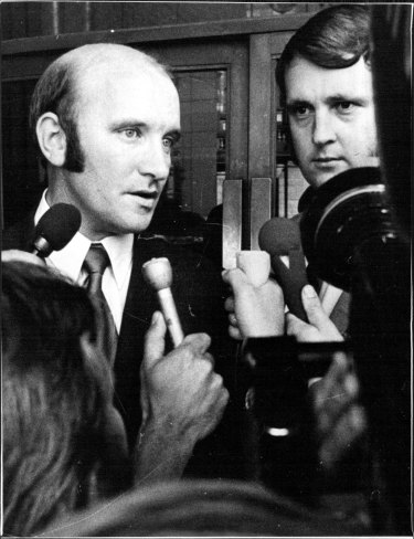 Then senior detective Brian Murphy, left, and constable Carl Stillman speak to the press in March 1972, after a Melbourne court acquitted them over the death in custody of Neil Collingburn.
