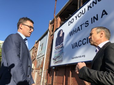Perth MP John Carey and Health Minister Roger Cook are looking for ways to have any anti-vax billboard pulled down.