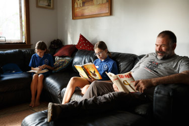 Stay-at-home dad Andrew Brownrigg says he'd rather drive a cheaper car and spend more time with his daughters Nadia, 9, and Astrid, 11.