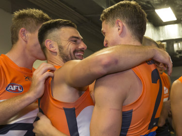 Spiritual leader: Stephen Coniglio embraces fellow midfielder Jacob Hopper after the win over Sydney.