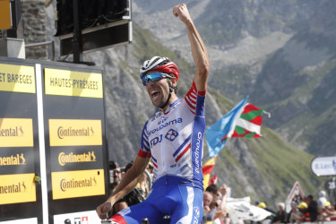 France's Thibaut Pinot celebrates as he crosses the finish line.