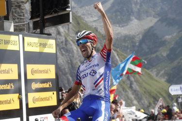 France's Thibaut Pinot celebrates as he crosses the finish line.