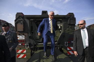 Malcolm Turnbull exits a Boxer  armoured fighting vehicle.